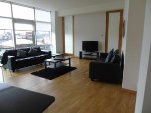 A seating area at Glasgow Lofts Serviced Apartments