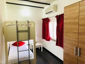 Een stapelbed of stapelbedden in een kamer bij Residence Windsurf