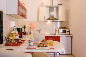A kitchen or kitchenette at Apartments Dora
