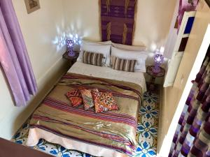 A bed or beds in a room at RIAD Dar Barbi Maison D'hôte