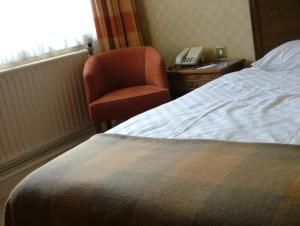 A bed or beds in a room at Roebuck Inn