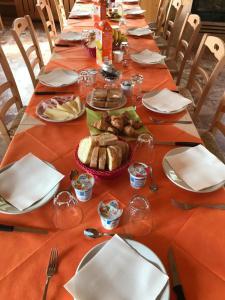 Ein Restaurant oder anderes Speiselokal in der Unterkunft Albergo De Jean
