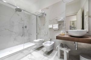 Um banheiro em Hotel Vivit ***S