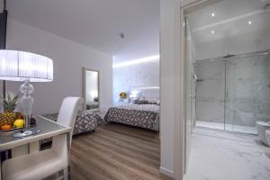 Cama ou camas em um quarto em Hotel Vivit ***S