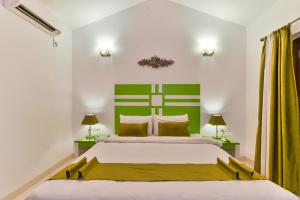 A bed or beds in a room at EKO STAY- CASA MIA VILLA