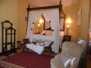 A bed or beds in a room at Balneario de Corconte