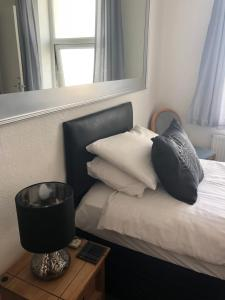 A bed or beds in a room at Edelweiss Guest House