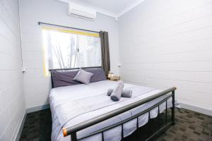 A bed or beds in a room at Mad Monkey Backpackers Village