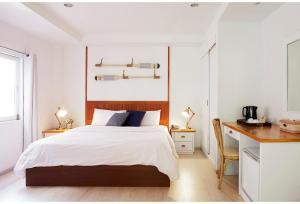 Кровать или кровати в номере Malibu Koh Samui Resort & Beach Club