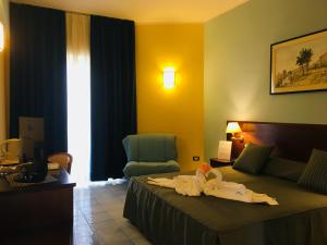 Letto o letti in una camera di Grand Hotel L'Approdo