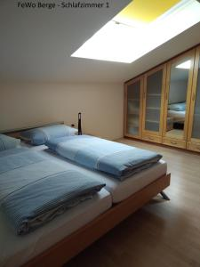A bed or beds in a room at Haus Ellerbeck