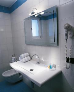 Een badkamer bij Hotel Bella Italia