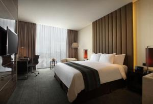 A bed or beds in a room at Po Hotel