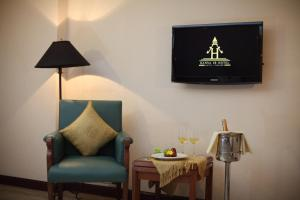 A seating area at Hansa JB Hotel, Hatyai