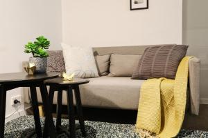 A seating area at HugoHome Designed Suites@Southern Cross
