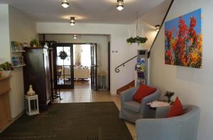 Ein Sitzbereich in der Unterkunft Hotel Forsthaus St. Hubertus