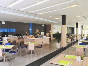 A restaurant or other place to eat at Ibis Phuket Kata