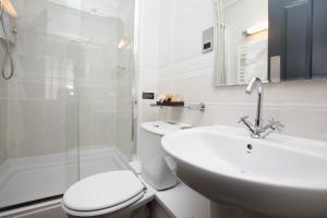 A bathroom at The Sun Hotel & Bar