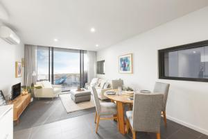 A television and/or entertainment center at Ascent Apartment with Ocean Views by Ready Set Host