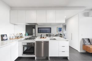 A kitchen or kitchenette at Ascent Apartment with Ocean Views by Ready Set Host