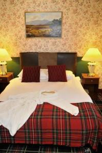 A bed or beds in a room at Loch Ness Lodge Hotel