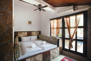 A bed or beds in a room at Villa Anri