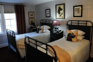 A bed or beds in a room at The Lyme Inn