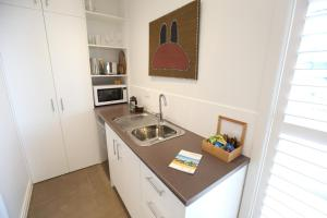 A kitchen or kitchenette at Mt Martha Villas