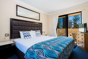 A bed or beds in a room at Island Beach Resort