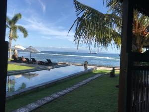 The swimming pool at or near Sea Breeze Candidasa