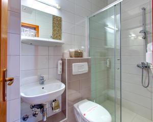 Kupaonica u objektu Hotel Almira