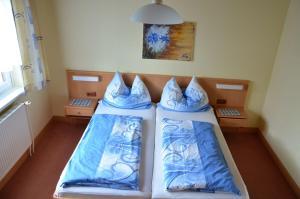 Ein Bett oder Betten in einem Zimmer der Unterkunft Gästehaus Familie Grudl
