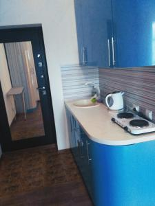 A kitchen or kitchenette at Apartment on Lenina