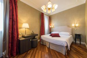 A bed or beds in a room at Hotel Campiello