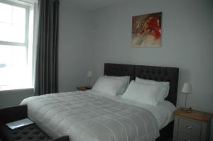 A bed or beds in a room at Maryfield House Hotel