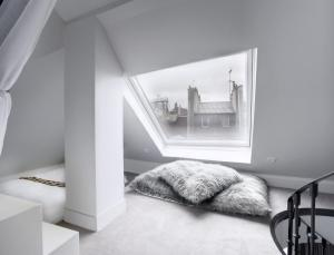 A bed or beds in a room at Boutique Hôtel Konfidentiel