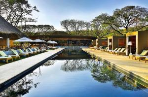 The swimming pool at or near El Mangroove Papagayo, Autograph Collection