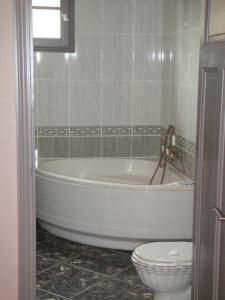 Salle de bains dans l'établissement Auberge des Lices
