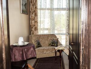 A seating area at City Center Kaķis B&B