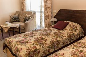 A bed or beds in a room at City Center Kaķis B&B