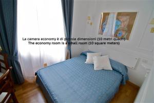 Letto o letti in una camera di InternoRoma