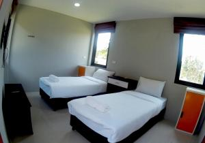 A bed or beds in a room at Sirinsamui Boutique Hostel