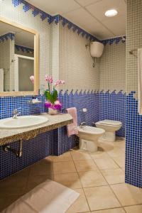 Ванная комната в Hotel Libyssonis