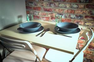 A kitchen or kitchenette at JDK Apartamenty Kalisz Podmiejska