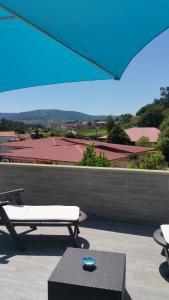 A balcony or terrace at Apartamento Castrelos