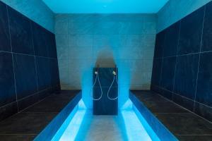 Ванная комната в Hotel Latemar