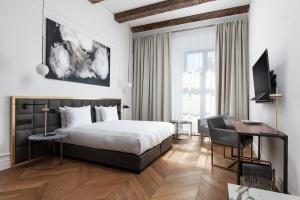 A bed or beds in a room at Hotel PACAI