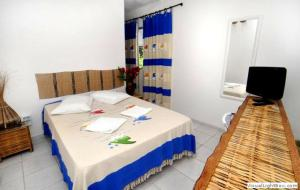 A bed or beds in a room at Estalagem Maceió