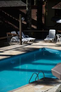 The swimming pool at or near Estalagem Vila Suzana