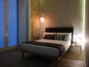 A bed or beds in a room at B&B NAPOLI AMORE MIO